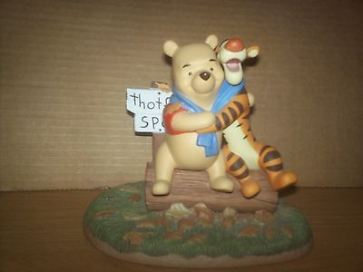 "Disney's Winnie the Pooh & Tigger figurine ""Fall colors charm us as leaves blow."