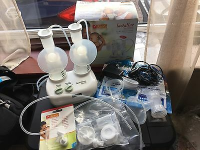 Breast pump - Ameda  lactaline dual breast pump plus EXTRAS (see description)