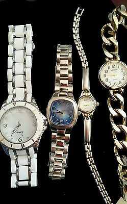 Watch lot of 4 working watches all have new Batteries.  Stainless
