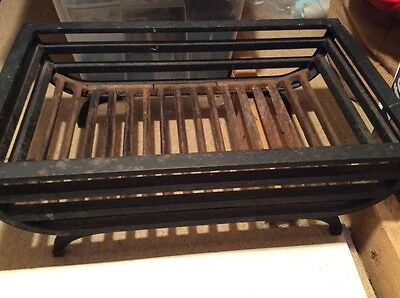 Cast Iron fire grate or basket.