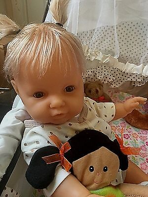 18 Inch Anatomically Berjusa from Spain baby girl with blond hair and brown eyes