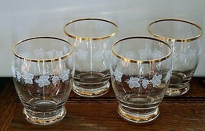 A set of 4 fine Tumbler glasses with gilt and printed grape design