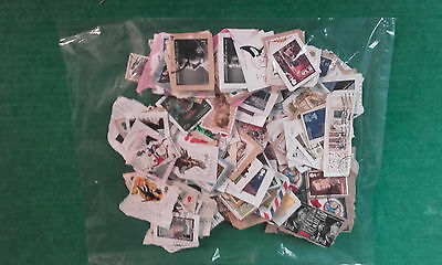 250 approx GB COMMEMORATIVE STAMPS USED ON PAPER INC HIGH VALUES