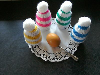 Pretty knitted egg cosies in  assorted and white x 4