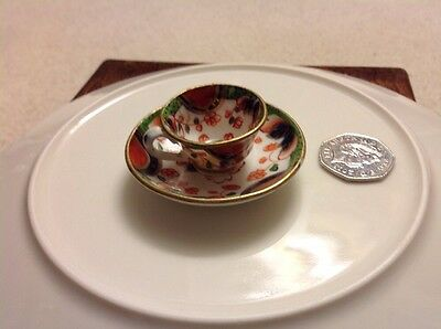 Miniature hand painted Gaudy Welsh Ceramic Tea Cup And Saucer