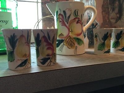 Pitcher and four cups