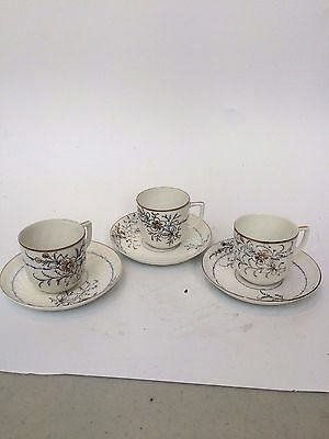 Antique Russian Kuznetsov set of Three Porcelain Floral Cups and Saucers
