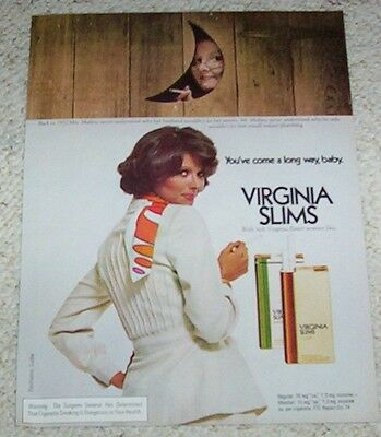 1975 print ad - Virginia Slims cigarettes Mrs Mullins smoking in outhouse ADVERT