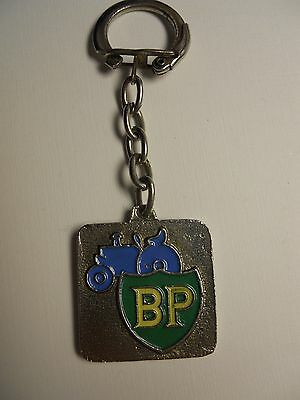 VINTAGE BP STATION TRACTOR LOGO ARABIC METAL KEYCHAIN from MOROCCO VERY RARE