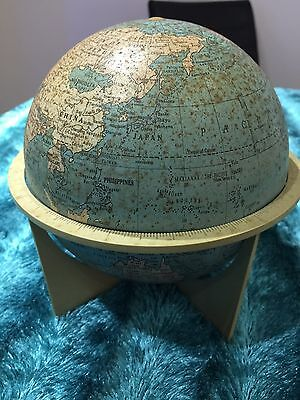 a vintage small metal tin plate globe in a stand rare