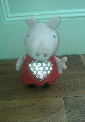 Pepper Pig soft toy with multi colour light up heart
