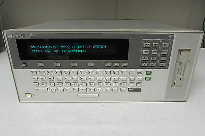 Agilent HP E1301A VXI Mainframe, 7-Slot w/ two Z2309A, one E1330B modules