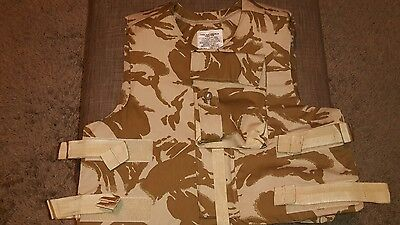 British army body armour vest includes filler and ceramic plates.