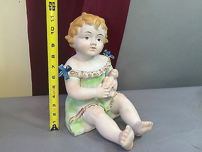"""Antique Bisque Porcelain Piano Baby German Figurine  LARGE 12"""" Tall Holding Doll"""