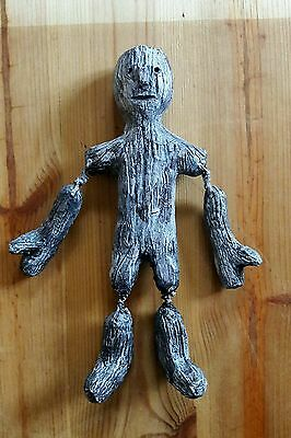 folk art carved primitive handmade figure bought in France 10 inches tall .