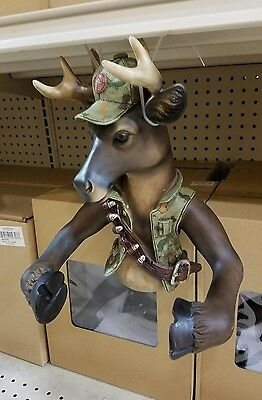 resin deer in camo or hunters outfit toilet paper holder