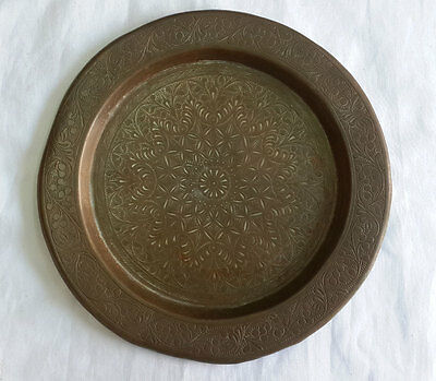 An old islamic plate collectible mughal style carving of flower patterns.