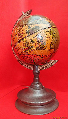 Vintage globe on stand with antique map