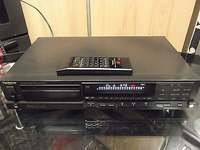 Technics SL-P350 Compact Disc Player with remote control and instructions