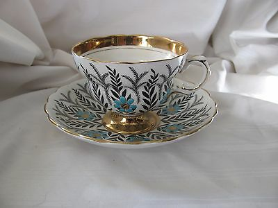 Rosina black white raised turquoise blue flowers footed cup saucer gold 5197