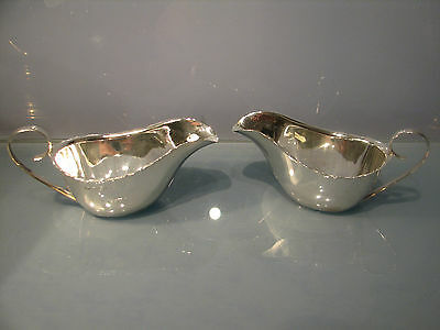 Art Deco 1937 pair of solid silver sauce boats plain silver 123grms.