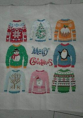 completed cross stitch christmas jumpers