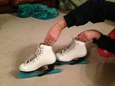 Ice Skates in white leather size 2 with blade cover and pink boot covers