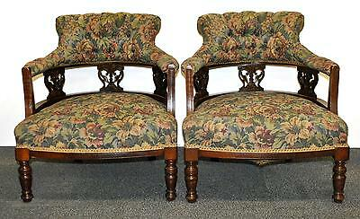 A pair of Edwardian upholstered tub chairs.