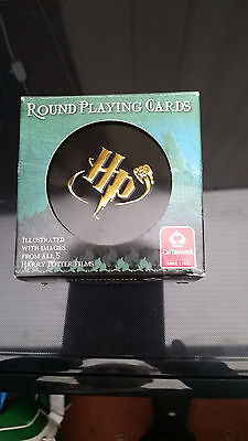 Harry Potter round playing cards in a tin
