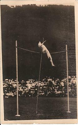 Postcard of an unidentified athlete pole vaulting