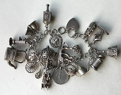 Vintage Solid Silver Charm Bracelet Laden with 18 Silver Charms