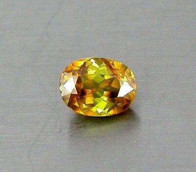 IF .68 Ct Top Quality Redish Fire Multi Color Natural Titanite Sphene