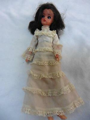 Vintage 70s Sindy doll in long cream dress brunette with blue eyes