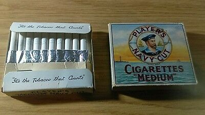 Players Navy Medium Cut full 20 cigarettes within.