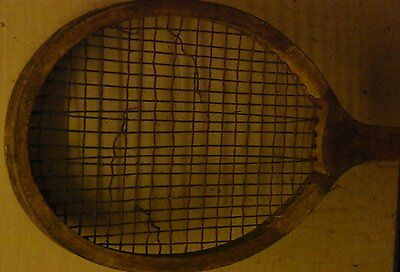 Very old tennis racket and press