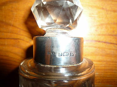 antique cut glass bottle silver top and cut glass stopper
