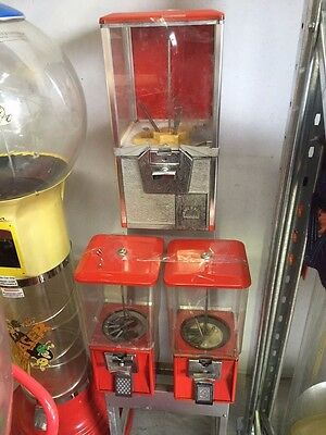Coin operated Scanlan 3 way confectionery and toy vending machine on stand