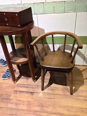 antique old wooden childrens chair in the style of a windsor chair