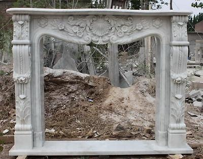 Hand carved marble fireplace mantel, French Design. All carved from solid blocks
