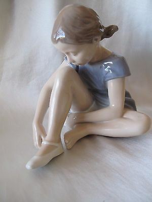 Royal Copenhagen Figurine Of Young Girl Putting On Shoes