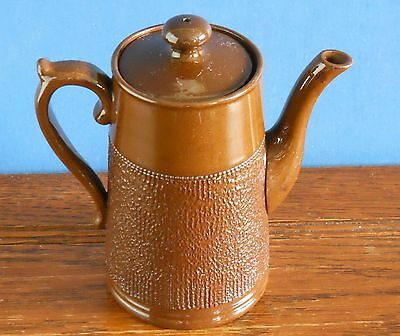 An Antique Staffordshire coffee pot with roughcast finish