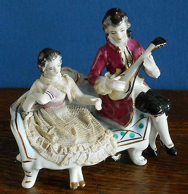A Vintage Porcelain figurine lace details  continental lovers / musician style