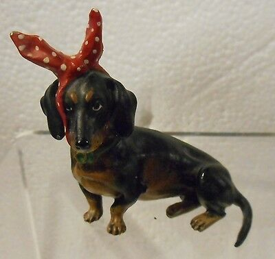 Sitting Dachshund with Toothache Cloth Bronze Dog Vienna