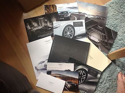 Collection Of 9 Aston Martin Brochures And Card Pack      Cardiff Stratstone