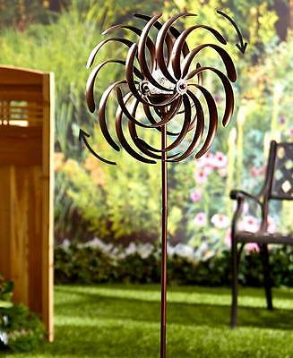 Dual Spiral Solar Garden Spinner with evening lighting