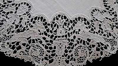 "antique doily white linen w figural lace border, 8.5"" d, needle lace? schiffli?"