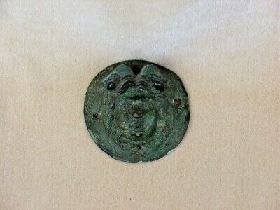 Ancient Bronze Roman Shield Boss cover as a Medusa or Nemesis head auction house