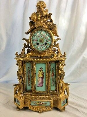 19th Century French Clock by Phillipe Mourey Cherubs, Porcelain Panels, Gilt