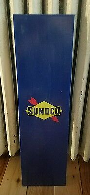Vintage plastic Sunoco sign. Advertisement from side of telephone booth