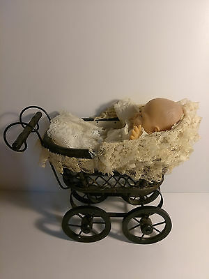 metal wicker baby buggy/carriage and a Eugene Doll Vintage 1987
